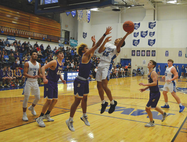 Junior guard Kevin Johnson (25) puts up a shot, during first-half action against visiting Butler, Feb. 11 at Xenia High. Butler won the boys high school varsity basketball game, 57-43.