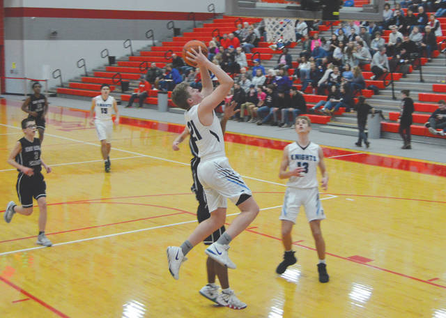 Brett Carson, of Legacy Christian, drives in for a score Feb. 21 in a boys high school basketball Division IV sectional tournament game win over East Dayton Christian, at Troy High School.