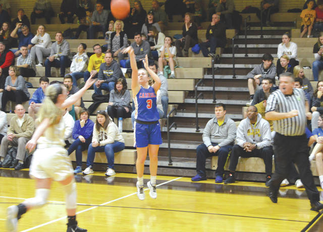 Carroll sophomore guard Sarah Ochs (3) puts up a three-point shot in the first half, Feb. 5, in a Greater Catholic League Co-Ed girls basketball game win over host Kettering Alter.