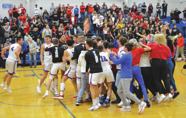 Greeneview players and fans celebrate moments after winning 58-56 over Cedarville, Feb. 7 in Jamestown.