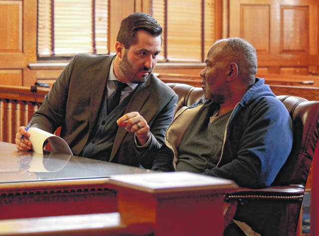 Anna Bolton | Greene County News Defense Attorney Adam Arnold speaks with defendant Winston Sheppard at his plea and sentencing hearing Feb. 28 in Greene County Common Pleas Court.