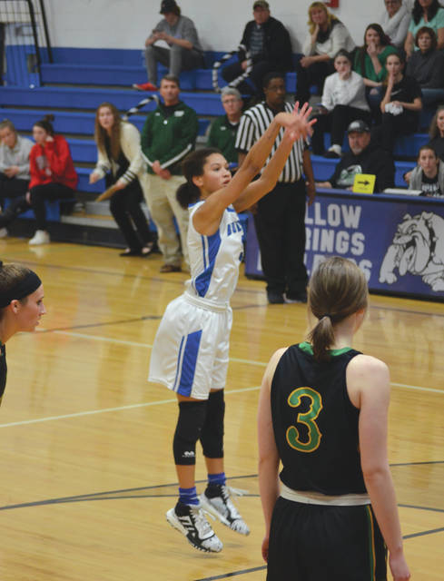 All eyes are on Yellow Springs sophomore Angie Smith as she hits the winning free throw, Thursday Feb. 6, in a win over Troy Christian, at Yellow Springs High.