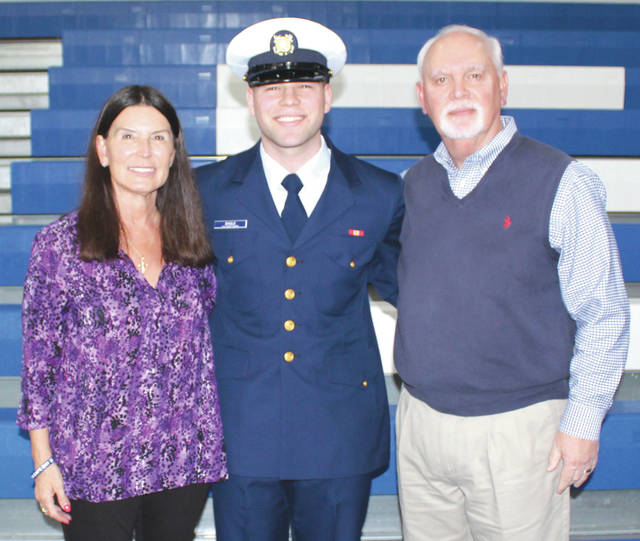 Submitted photo Fairborn residents Linda Engle, Coast Guard E 3 Lyndon Engle and Tom following graduation ceremonies at the U.S. Coast Guard Training Center in Cape May, New Jersey.