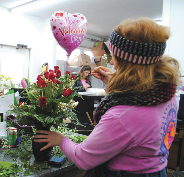 Whitney Vickers | Greene County News Hollon Flowers has several flower orders ready for a Valentine's Day delivery. Five delivery vans will take off as early as 8 a.m. and will work until close delivering flowers and Valentine's Day mementos