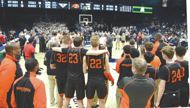 The Beavercreek team respectfully looks on as the district championship trophy is presented to Lakota East, Sunday March 8 at Xavier University's Cintas Center in Cincinnati.