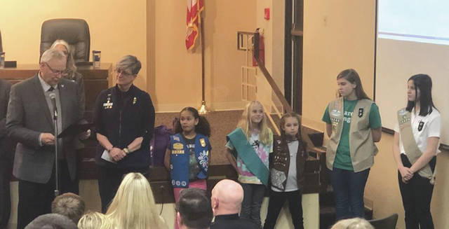 Submitted photos The City of Fairborn proclaimed March 8-13 as Girl Scout Week across the community. Fairborn Mayor Paul Keller was sworn-in as an honorary Girl Scout in the spirit of the proclamation.
