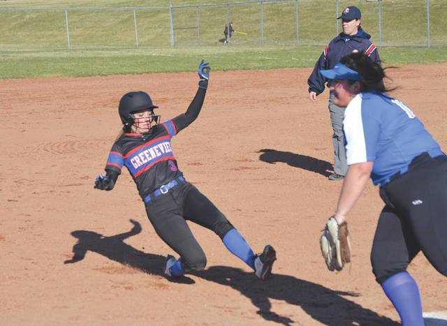 Greeneview's Alexa Simpson slides safely into third, in a game last season against Xenia. The Rams rallied in the eighth to take a simulated win from Ohio Heritage Conference foe Cedarville on Friday.
