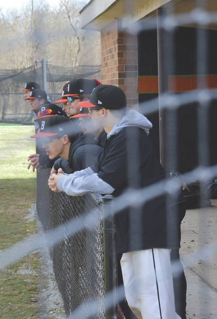 Beavercreek High School baseball players look on from the dugout during an intersquad scrimmage game last season.