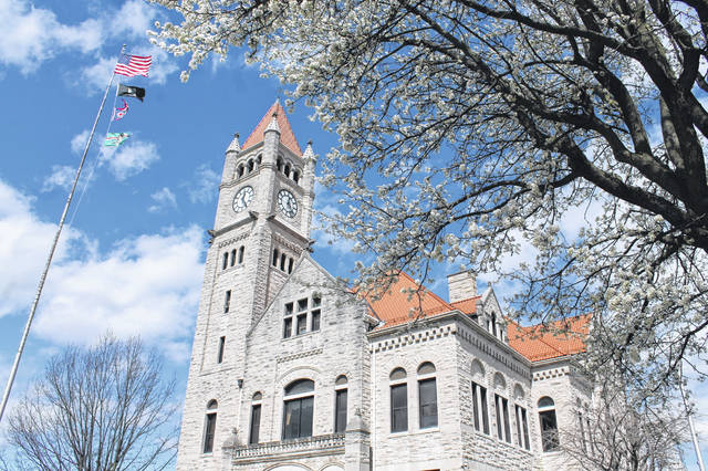 Anna Bolton | Greene County News Flags fly over the Greene County Courthouse March 29 in Xenia. Readers who do not have a flag to fly outside their home can pull the flag poster from the inside of today's paper and display it in their window.