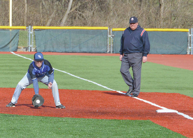 Yellow Springs' Colton Bittner brings in a ground ball, as the umpire looks on, in this photo from the 2019 high school baseball season. Fairborn's Kahlil Lettice follows through on a hit last season at West Carrollton.