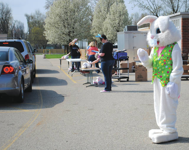 Whitney Vickers | Greene County News The Easter bunny makes an apperance at the Fairborn City Schools weekly lunch bag distribution event.