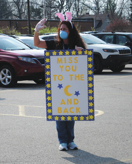 File photo Fairborn Primary School Assistant Principal Valerie Herdman holding a sign during the weekly lunch bag distribution event.