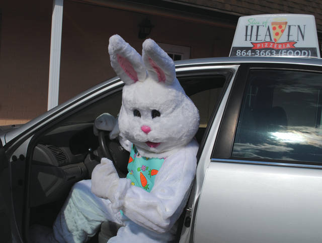 Whitney Vickers | Greene County News The Easter bunny will accompany A Slice of Heaven Pizzeria delivery drivers on Friday, April 10 and Saturday, April 11. Customers should indicate when ordering that they wish for the Easter bunny to be present during their delivery.