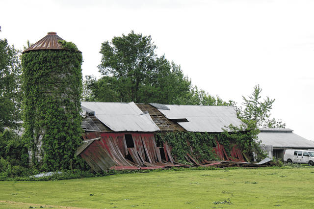 File Photos Property near Gilbert's Party Barn on Trebein Road suffered damage from the EF3 tornado.
