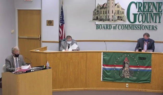 Screenshot of video meeting Commissioners Tom Koogler, Bob Glaser and Dick Gould, masked and distanced, meet in session inside the county building May 14 for the first time in several weeks.