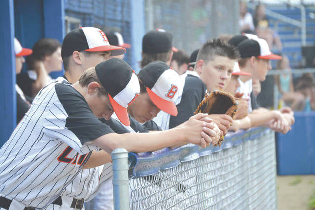 Beavercreek players show their concern from the dugout in a tight high school baseball contest last season.