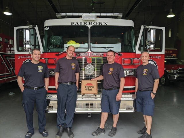 Submitted photo Fairborn firefighters ate well Sunday night, thanks to a thoughtful gift from a community member. Myles, 8, of Fairborn, used his birthday money to buy the firefighters pizza for dinner.