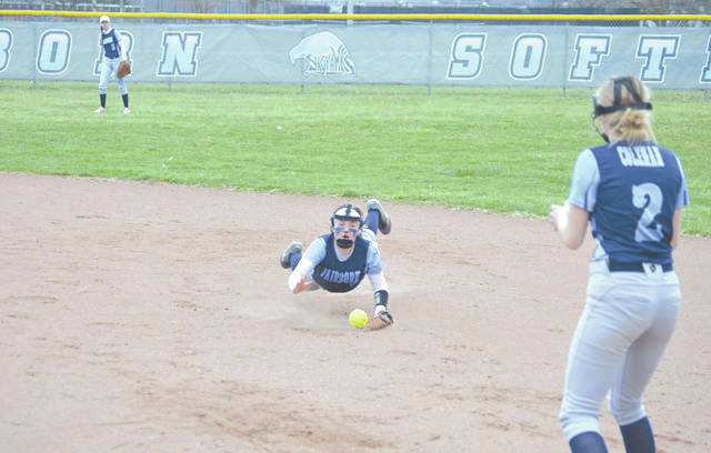 Madison Durban dives to stop a ground ball to second, then flips to Fairborn first baseman Kelsie Coleman for the out, in high school softball action last season.