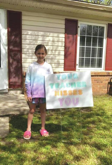 Submitted photo Fairborn Primary School second grade teacher Mollie Engle delivered yard signs and messages to her students to let them know that they are missed.
