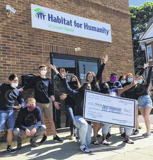 Submitted photos Compassion in Action donated $500 toward a Habitat for Humanity build.