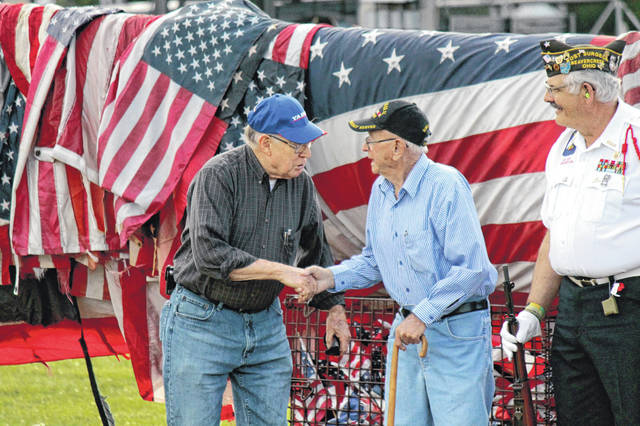 File photo A flag retirement ceremony will take place at the Greene County Fairgrounds again this year on Flag Day, Sunday, June 14. Pictured, veterans are recognized during the 2019 ceremony.