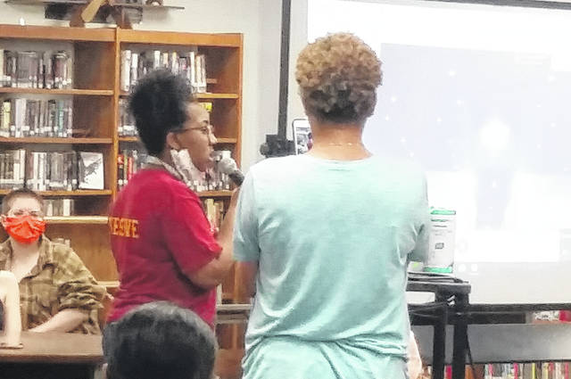 A student voices her concerns during the meeting.