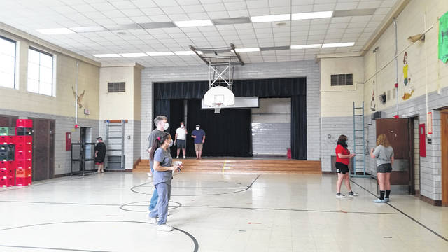 London Bishop | Greene County News Visitors roam the gym of Fairborn Intermediate, swapping stories and memories of their time there.