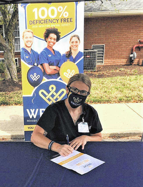 Submitted photo Nurses sign the Healthcare Angel's Pledge to abide by COVID-19 precautions even when out in the community.