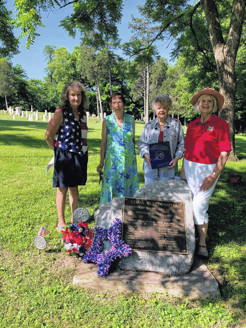 Submitted photo Cedar Cliff Chapter of Daughters of the American Revolution (DAR) members Gayle Hartman, Kathy Pignotti, Judith Hudson and Linda Sears place a wreath at the DAR marker in Stevenson Cemetery July 4, remembering Greene County Revolutionary War soldiers.
