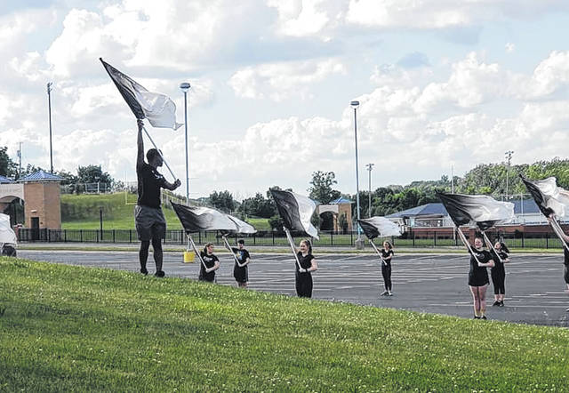 Submitted photos Fairborn color guard members practice outside.