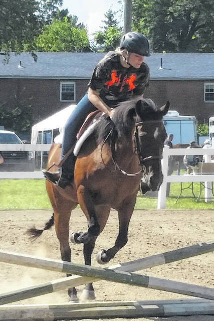 London Bishop | Greene County News Riley Lawless clears a crossrail during the Horse Fun Show on Saturday.