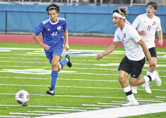 Photos by Scott Halasz | Greene County News Bellbrook's Ethan Harris (2) tries to outrace Carroll's Ben Del Cid (46) to a ball during the first half of a boys soccer game Saturday. Carroll won, 2-1, with a late penalty kick.