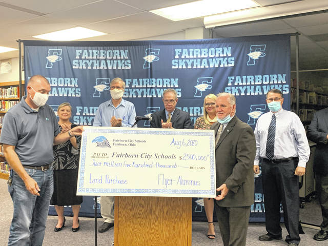 Board of Education members receive the anonymous $2.5 million donation.