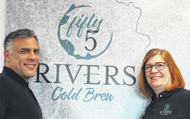 Submitted photo James and Lynne Mowery co-founded Fifty5 Rivers Cold Brew in 2018, and held the grand opening of their Fairborn location on Aug. 1.