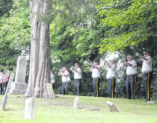 Beavercreek VFW Post 8312 Honor Squad fires a ceremonial rifle salute Aug. 14 at Caesarscreek Baptist Church Cemetery in New Jasper Township.