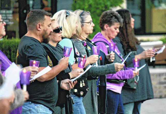 File photo Community members participate in Family Violence Prevention Center's candlelight vigil at The Greene Town Center last October. This year's event will be held virtually through Facebook on Monday, Oct. 5.
