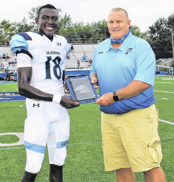 Fairborn's Patrick Parrish received the Clifton Spahr Integrity Award prior to Friday's win over Xenia. He is presented the award by Athletic Director Kevin Alexander. The award is named in memory of long-time school educators Bill Spahr (Xenia) and Steve Clifton (Fairborn).