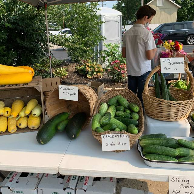 Submitted photo | Vendors set up at last week's Farmer's Market selling all sorts of produce, flowers, and other goods.