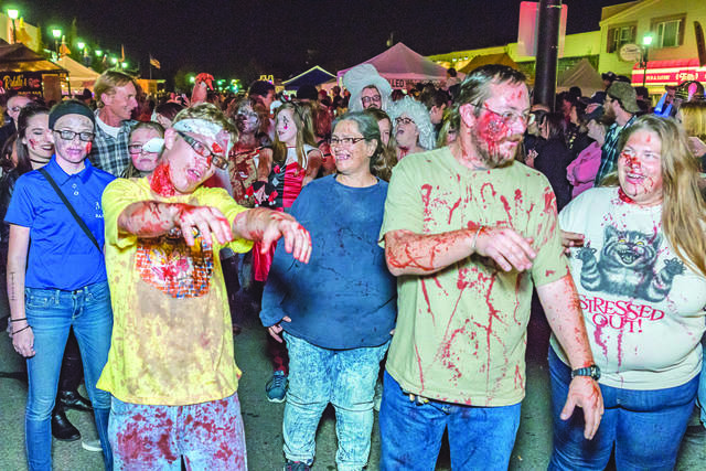 """Participants during the """"zombie walk"""" in a previous year. This year's event has been cancelled due to concerns over COVID-19."""