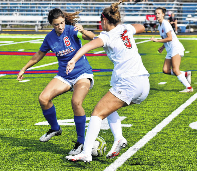 Carroll defensive midfielder Catherine Berent (6) gets in the way of an opponent before she can pass to a teammate. Berent, normally a defender, moved to the midfield this year and has been the glue of the defense, according to Coach Sarah Flach.