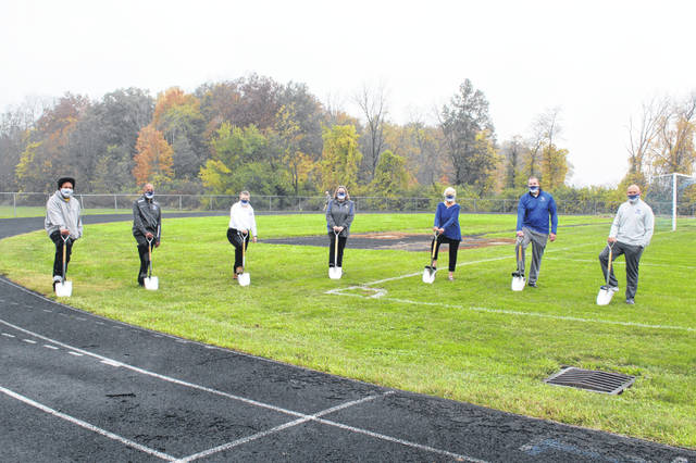 Board member Steve McQueen, Mills Lawn Counselor and YSHS Co-Ed Assistant Cross Country & Men's Track Coach John Gudgel, Superintendent Dr. Terri L. Holden, Treasurer Tammy Emrick, Board Vice President Aida Merhemic, McKinney Middle School & YSHS Principal Jack Hatert, and Director of Business Operations & Athletics Jeff Eyrich break ground.