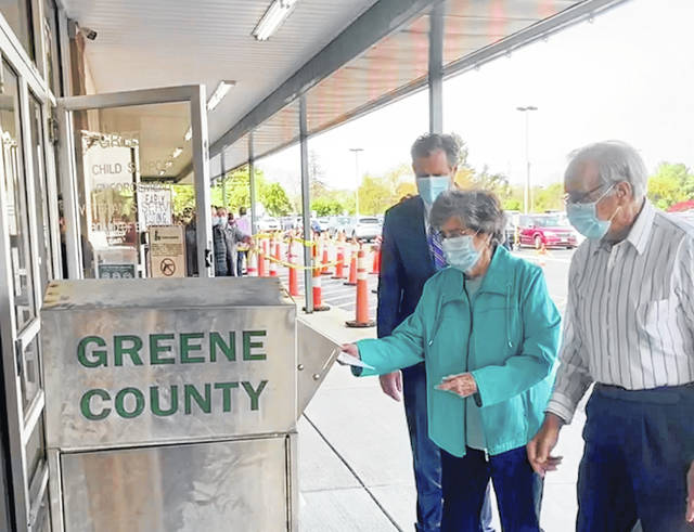 Submitted photo U.S. Congressman Mike Turner (R-Dayton) accompanied his parents, Ray and Vivian, when they dropped off their ballots at the Greene County Board of Elections. Turner was there to show the ease and safety of voting absentee and returning ballots.