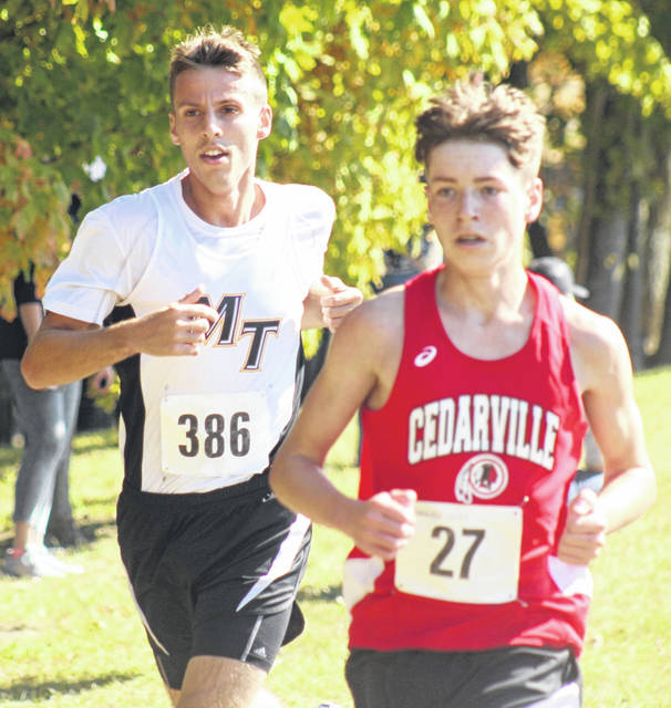 Cedarville's Caleb Sultan makes his way to a fourth-place finish at Cross the Creek cross country meet.