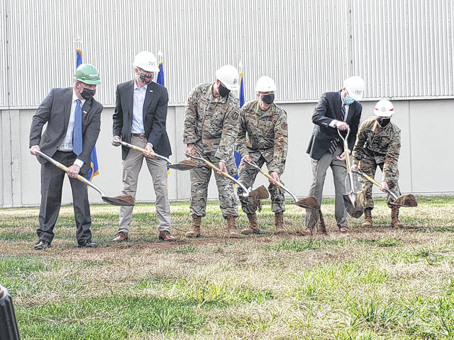 Officials break ground on the site of Intelligence Production Complex III at NASIC. From Left to Right: Kevin Cozart, senior VP of Messer Construction, Sen. Rob Portman, Col. Patrick Miller, Col. Maurizio Calabrese, Rep. Mike Turner, and Col. Eric Crispino, Army Corps of Engineers.