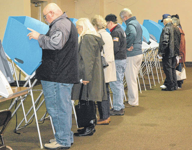 File photo While a record number of people participated in early and absentee voting, many will be at the polls today as well. Election officials say results may not be known for days after the election due to the number of absentee ballots.