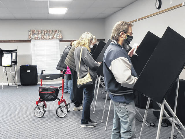 Voters in Bath Township exercise their right.