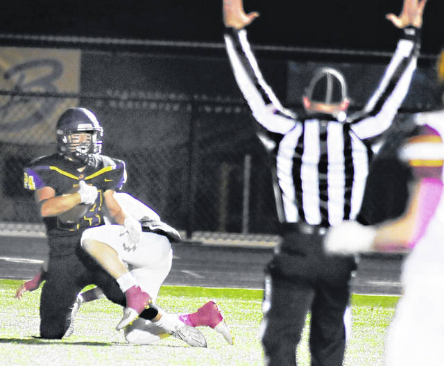 Photos by Charles Caperton | Greene County News Bellbrook's Ethan Fryman looks for the official's TD signal after making a 26-yard catch to give the Golden Eagles a 13-7 lead.
