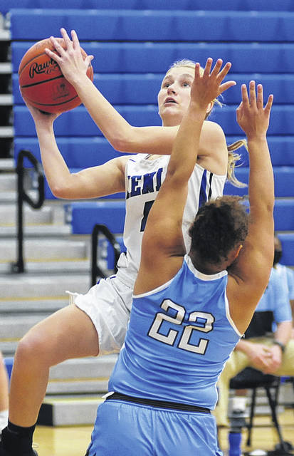 Photos by Charles Caperton | Greene County News Xenia sophomore Kendall Sherman (4) shoots while Fairborn senior Jodee Austin defends without fouling.