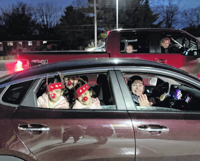 Families participated in the Fairborn Primary and Fairborn Intermediate Schools Holiday Parade Monday night, dressed in festive costumes.