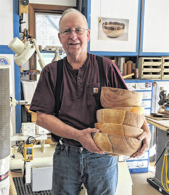 Lowell Converse in his woodturning shop.